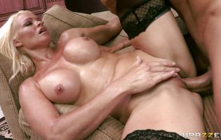 Voluptuous blonde diva Rhylee Richards gets drilled by a muscular bf